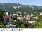 Купить «Becici, Montenegro - June 8. 2019. The resort village of Becici in the community of Budva», фото № 33182489, снято 8 июня 2019 г. (c) Володина Ольга / Фотобанк Лори