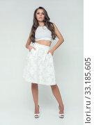 Купить «girl in white skirt studio posing romantic», фото № 33185605, снято 28 февраля 2020 г. (c) PantherMedia / Фотобанк Лори