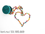 Heart shaped colorful beads isolated on white. Стоковое фото, фотограф Anton Eine / PantherMedia / Фотобанк Лори