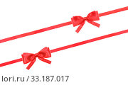 red satin bow knot and ribbons on white - set 58. Стоковое фото, фотограф Valery Vvoennyy / PantherMedia / Фотобанк Лори