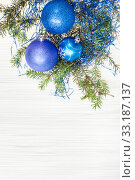 Купить «three blue and violet Xmas baubles, twig on paper», фото № 33187137, снято 14 июля 2020 г. (c) PantherMedia / Фотобанк Лори