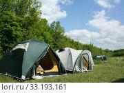 Купить «tourist tents in forest at campsite», фото № 33193161, снято 13 июля 2020 г. (c) PantherMedia / Фотобанк Лори
