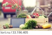 Купить «close up of vegetables with tablet pc on farm», фото № 33196405, снято 25 августа 2016 г. (c) Syda Productions / Фотобанк Лори