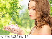 Купить «beautiful woman with rose flower petals», фото № 33196417, снято 10 октября 2010 г. (c) Syda Productions / Фотобанк Лори