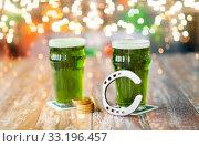 Купить «glasses of green beer, horseshoe and gold coins», фото № 33196457, снято 31 января 2018 г. (c) Syda Productions / Фотобанк Лори