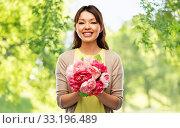 Купить «happy asian woman with bunch of flowers», фото № 33196489, снято 11 мая 2019 г. (c) Syda Productions / Фотобанк Лори