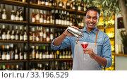 Купить «indian barman with glass of cocktail and shaker», фото № 33196529, снято 17 ноября 2019 г. (c) Syda Productions / Фотобанк Лори
