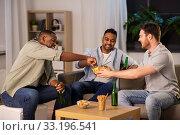 Купить «male friends drinking beer with crisps at home», фото № 33196541, снято 28 декабря 2019 г. (c) Syda Productions / Фотобанк Лори