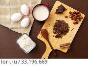 Купить «chocolate, cocoa powder, milk, eggs and flour», фото № 33196669, снято 1 февраля 2019 г. (c) Syda Productions / Фотобанк Лори