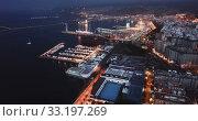 Купить «Evening panoramic view of Mediterranean coastal city of Almeria with harbor, Spain», видеоролик № 33197269, снято 22 мая 2019 г. (c) Яков Филимонов / Фотобанк Лори