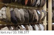 Купить «Large assortment of flat caps hanging on showcase in clothes shop», видеоролик № 33198377, снято 3 апреля 2020 г. (c) Яков Филимонов / Фотобанк Лори