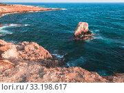 Купить «Rocky islet and coastal rocks at Mediterranean Sea», фото № 33198617, снято 12 июня 2018 г. (c) EugeneSergeev / Фотобанк Лори