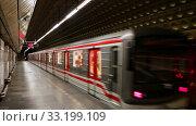 Купить «Inside view of Hradcanska Metro station with underground carriage in Prague», видеоролик № 33199109, снято 13 октября 2019 г. (c) Яков Филимонов / Фотобанк Лори