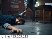 Купить «Maniac kidnapper drags his victim across the floor», фото № 33203213, снято 13 ноября 2019 г. (c) Tryapitsyn Sergiy / Фотобанк Лори