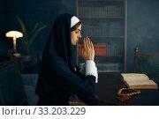 Купить «Young nun in a cassock prays crossed her arms», фото № 33203229, снято 14 ноября 2019 г. (c) Tryapitsyn Sergiy / Фотобанк Лори