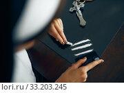 Купить «Sexy nun in a cassock sniffing cocaine», фото № 33203245, снято 14 ноября 2019 г. (c) Tryapitsyn Sergiy / Фотобанк Лори