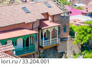 Купить «View of the roofs of houses in the center of Tbilisi. Old city and tiled roofs in Georgia», фото № 33204001, снято 5 августа 2020 г. (c) Николай Коржов / Фотобанк Лори