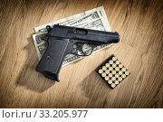 Купить «pistol with cartridges and dollar notes», фото № 33205977, снято 31 марта 2020 г. (c) PantherMedia / Фотобанк Лори