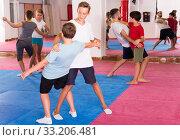 Купить «Kids exercising self-defense movements», фото № 33206481, снято 6 августа 2018 г. (c) Яков Филимонов / Фотобанк Лори