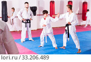 Children working in pair mastering new karate moves. Стоковое фото, фотограф Яков Филимонов / Фотобанк Лори