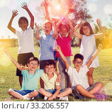Купить «Portrait of eight children who are walking and posing in the park», фото № 33206557, снято 8 апреля 2020 г. (c) Яков Филимонов / Фотобанк Лори