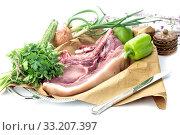 Купить «Piece of raw pork and vegetables on a white background», фото № 33207397, снято 21 февраля 2020 г. (c) Татьяна Ляпи / Фотобанк Лори