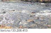 Купить «Dolly slider shot of the splashing water in a mountain river near forest. Wet rocks and sun rays. Horizontal steady movement. Raw flat colors.», видеоролик № 33208413, снято 9 сентября 2018 г. (c) Александр Маркин / Фотобанк Лори