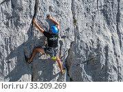 Rock climber climbing rock face in the Gorges du Verdon / Verdon Gorge canyon, Alpes-de-Haute-Provence, Provence-Alpes-Cote d'Azur, France, September 2018. Стоковое фото, фотограф Philippe Clement / Nature Picture Library / Фотобанк Лори