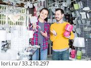 Two buyers decide to buy a night lamp. Стоковое фото, фотограф Яков Филимонов / Фотобанк Лори
