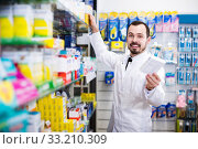 Male pharmacist in pharmacy. Стоковое фото, фотограф Яков Филимонов / Фотобанк Лори