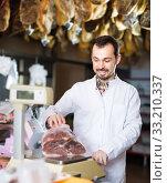 Positive assistant weighing on scales piece of meat. Стоковое фото, фотограф Яков Филимонов / Фотобанк Лори