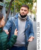 Купить «Woman stopping man bothering her on street», фото № 33210389, снято 25 февраля 2020 г. (c) Яков Филимонов / Фотобанк Лори