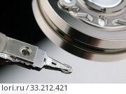Купить «Головка жесткого диска компьютера», фото № 33212421, снято 11 февраля 2020 г. (c) Игорь Долгов / Фотобанк Лори