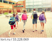 group of happy elementary school students running. Стоковое фото, фотограф Syda Productions / Фотобанк Лори