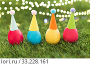 Купить «easter eggs in party hats on artificial grass», фото № 33228161, снято 15 марта 2018 г. (c) Syda Productions / Фотобанк Лори