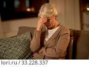 unhappy senior woman suffering from headache. Стоковое фото, фотограф Syda Productions / Фотобанк Лори