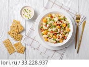 Купить «cauliflower salad with bacon, cheese, green peas», фото № 33228937, снято 28 ноября 2019 г. (c) Oksana Zh / Фотобанк Лори