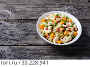 Купить «cauliflower salad in a white bowl, close-up», фото № 33228941, снято 28 ноября 2019 г. (c) Oksana Zh / Фотобанк Лори