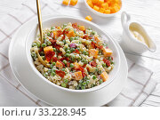 Купить «elbow macaroni salad with green peas, close-up», фото № 33228945, снято 28 ноября 2019 г. (c) Oksana Zh / Фотобанк Лори
