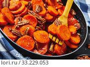 Купить «Candied sweet potatoes with pecan nuts, closeup», фото № 33229053, снято 30 ноября 2019 г. (c) Oksana Zh / Фотобанк Лори