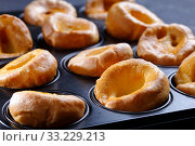 Купить «Yorkshire puddings in a metal baking tray», фото № 33229213, снято 13 декабря 2019 г. (c) Oksana Zh / Фотобанк Лори