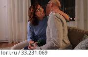 Купить «happy senior couple with gift box at home», видеоролик № 33231069, снято 4 января 2020 г. (c) Syda Productions / Фотобанк Лори