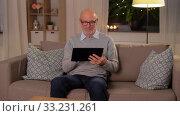 Купить «happy senior man with tablet computer at home», видеоролик № 33231261, снято 4 января 2020 г. (c) Syda Productions / Фотобанк Лори