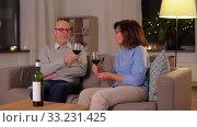 Купить «happy senior couple with glasses of red wine», видеоролик № 33231425, снято 4 января 2020 г. (c) Syda Productions / Фотобанк Лори