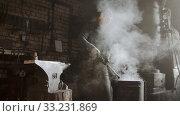 Купить «Blacksmith cooling out hot metal detail in the bucket of cool water», видеоролик № 33231869, снято 8 апреля 2020 г. (c) Константин Шишкин / Фотобанк Лори