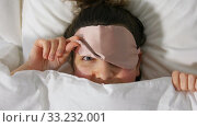 woman with eye sleeping mask in bed under blanket. Стоковое видео, видеограф Syda Productions / Фотобанк Лори