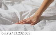 Купить «hand of woman touching bed covered with blanket», видеоролик № 33232005, снято 17 февраля 2020 г. (c) Syda Productions / Фотобанк Лори
