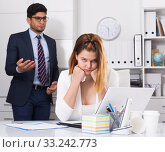 Купить «Frustrated business woman with angry chief», фото № 33242773, снято 1 июня 2017 г. (c) Яков Филимонов / Фотобанк Лори