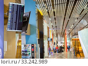 Купить «Arrival and departure board is in hall of the Koltsovo International Airport. Екатеринбург», фото № 33242989, снято 11 июля 2015 г. (c) Кекяляйнен Андрей / Фотобанк Лори