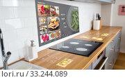 Купить «smart home kitchen with virtual displays», видеоролик № 33244089, снято 28 мая 2020 г. (c) Syda Productions / Фотобанк Лори